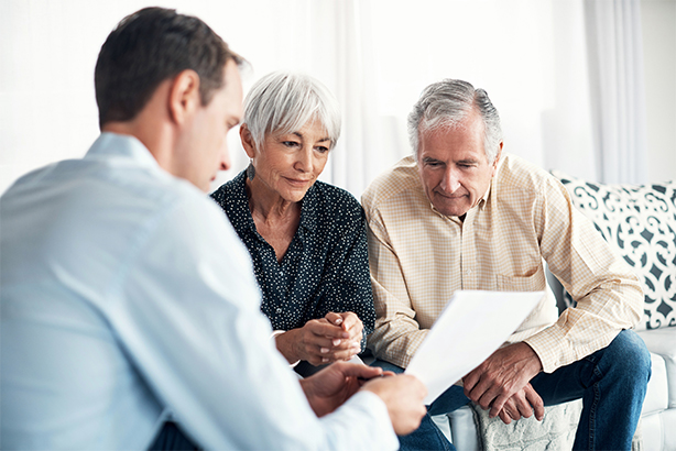 Elderly couple speaking to a financial advisor